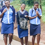 teenage girls walking on road